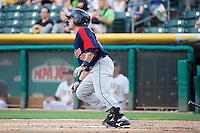 Humberto Quintero (35) of the Tacoma Rainiers at bat against the Salt Lake Bees in Pacific Coast League action at Smith's Ballpark on July 9, 2014 in Salt Lake City, Utah.  (Stephen Smith/Four Seam Images)