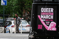 NEW YORK, NY - JUNE 1 : A man walks near a NYPD car as a poster with information about a queer march is displayed on a post on June 1, 2021. in New York City. New York City's Pride events organizers banned police and other law enforcement from marching during annual parade until 2025. (Photo by Eduardo MunozAlvarez/VIEWpress)