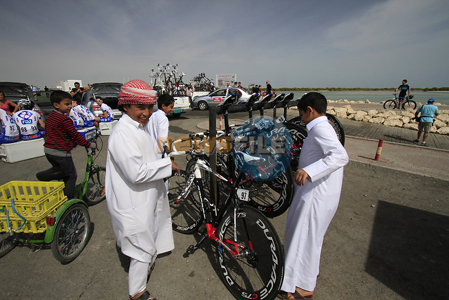 Local boys check out FDJ-BigMat's Lapiere team bikes before the start of Stage 4 of the 2012 Tour of Qatar from Al Thakhira to Madinat Al Shamal, Qatar. 8th February 2012.<br /> (Photo Eoin Clarke/Newsfile)