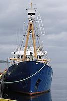 Covered harpoon gun on bow of Norwegian whaling boat at dock Norwegian sea Arctic Norway North Atlantic