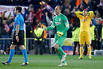 Atletico de Madrid's Jan Oblak (r) celebrates the victory in the Round of 16 of UEFA Champions League in presence of Bayer 04 Leverkusen's Bernd Leno dejected after the match.March 16,2015. (ALTERPHOTOS/Acero)