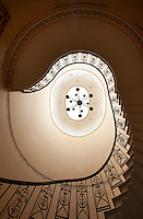View of the swirling, grand staircase at Hackthorn Hall from below