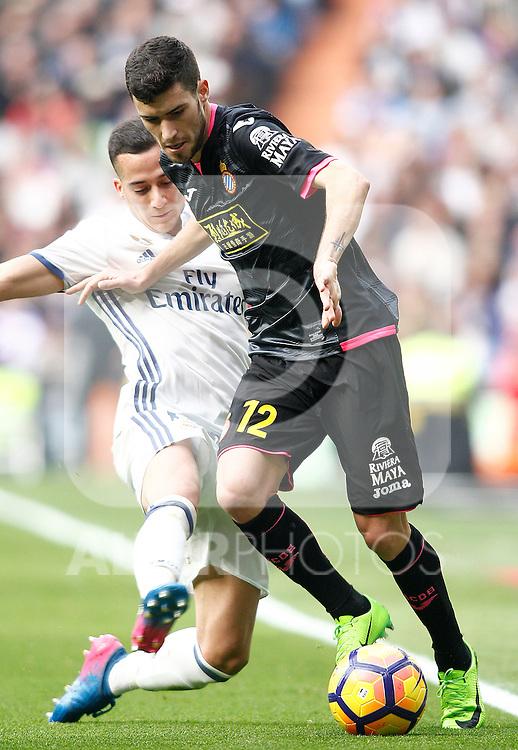 Real Madrid's Lucas Vazquez (l) and RCD Espanyol's Aaron Martin during La Liga match. February 18,2017. (ALTERPHOTOS/Acero)