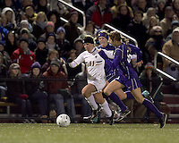 """Boston College defender Hannah Cerrone (11) moves down the wing as University of Washington midfielder Lindsey Bos (6) defends. In overtime, Boston College defeated University of Washington, 1-0, in NCAA tournament """"Elite 8"""" match at Newton Soccer Field, Newton, MA, on November 27, 2010."""