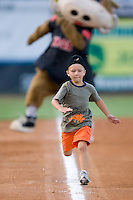 "A young fan races to home plate ahead of Wally the Warthog in the ever popular ""Mascot Race to the Plate"" at Ernie Shore Field in Winston-Salem, NC, Thursday July 27, 2008. (Photo by Brian Westerholt / Four Seam Images)"