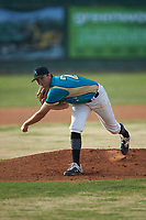Mooresville Spinners starting pitcher Maddux Holshouser (24) (UNC Greensboro) follows through on his delivery against the Lake Norman Copperheads at Moor Park on July 6, 2020 in Mooresville, NC.  The Spinners defeated the Copperheads 3-2. (Brian Westerholt/Four Seam Images)