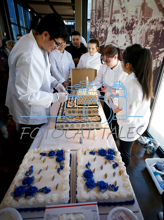 Carson High School culinary students set up the cake they created for the celebration of the 150th year of the Carson City Mint at the Nevada State Museum, in Carson City, Nev. on Tuesday, Feb. 4, 2020. <br /> Photo by Cathleen Allison/Nevada Momentum