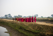 The 47-year-old leader of the Pink Gang, Sampat Pal Devi (leading the gang) is a fiesty woman. The barely educated, impoverished mother of five, Sampat Pal Devi has emerged as a messianic figure in the region. Sampath Devi began to work as a government health worker, but she quit soon after because her job was not satisfying enough. She always wanted to work for the poor and not for herself. Taking up issues while being a government worker was difficult, so she decided to quit the job and work for the rights of people...Amidst the gloom of extreme poverty, it's the colour of pink that's calling the shots in this dusty region of Bundelkhand, one of the poorest parts of one of India's northern and most populous states, Uttar Pradesh in India. A gang of vigilantes, called the Gulabi Gang (pink gang) - its 10,000 strong women members wear only pink sarees - is taking up lathi (traditional Indian cudgel) against domestic violence and corruption.