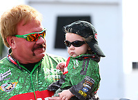 Apr 27, 2014; Baytown, TX, USA; NHRA top fuel dragster driver Terry McMillen  with his son Cameron McMillen during the Spring Nationals at Royal Purple Raceway. Mandatory Credit: Mark J. Rebilas-