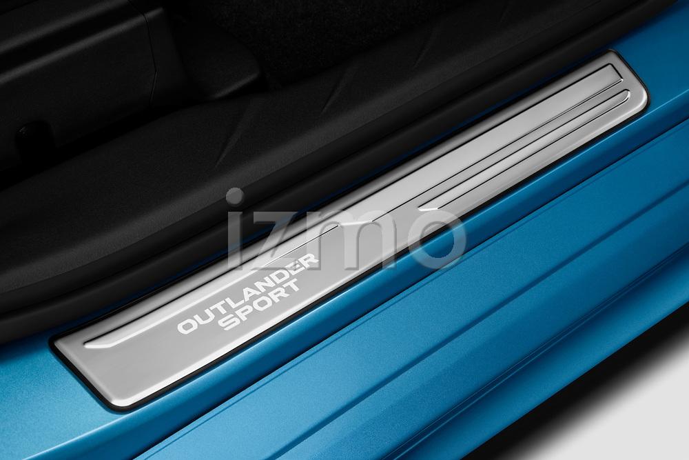 Scuff plate detail view of a 2011 Mitsubishi Outlander Sport SE