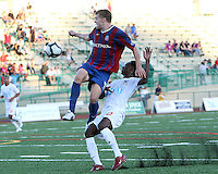 Andrew Marshall #5 of Crystal Palace Baltimore leaps in front of Gregory Richardson #20 of the Carolina Railhawks during an NASL match at Paul Angelo Russo Stadium in Towson, Maryland on September 18 2010.Carolina won 4-2.