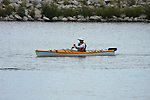 A women Kayaker kayaking in the harbor of Milwaukee Wisconsin in summer
