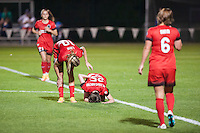 Kansas City, Mo. - Saturday April 23, 2016: Portland Thorns FC midfielder Allie Long (10) checks on teammate Meghan Klingenberg (25) after she fell due to injury during a match against FC Kansas City at Swope Soccer Village. The match ended in a 1-1 draw.
