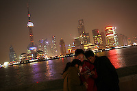 CHINA. Shanghai. Tourists on the Bund with the famous PuDong skyline behind them. Shanghai is a sprawling metropolis or 15 million people situated in south-east China. It is regarded as the country's showcase in development and modernity in modern China. This rapid development and modernization, never seen before on such a scale has however spawned countless environmental and social problems. 2008.