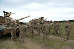 """American soldiers with Delta Company, 2nd Battalion, 7th Infantry Regiment, 1st Armored Brigade Combat Team, 3rd Infantry Division with M1A2 Abrams tanks prepare for the After Action Review during a tank training exercise practicing infiltration at the Drawsko Pomorskie Training Area in Poland on June 12, 2015.    NATO is engaged in a multilateral training exercise """"Saber Strike,"""" the first time Poland has hosted such war games, involving the militaries of Canada, Denmark, Germany, Poland, and the United States."""