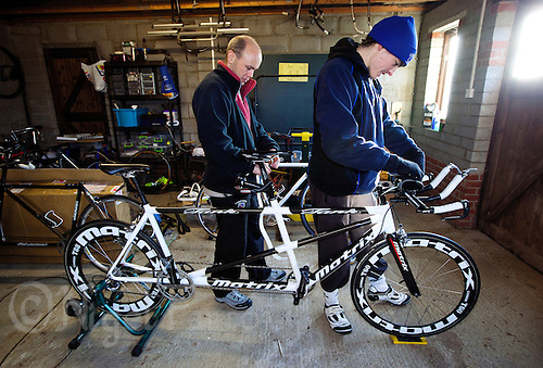 10 DEC 2011 - NORFOLK, GBR - Iain Dawson (left) and his guide Luke Watson set up the new tandem for a training ride during one of the few training weekends they will have together before the start of the new season (PHOTO (C) NIGEL FARROW)