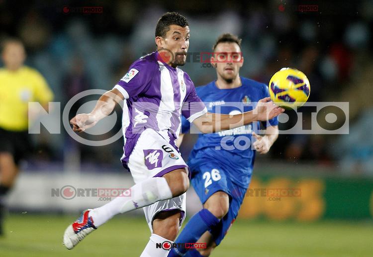 Getafe's Paco Alcocer (r) and Real Valladolid's Jesus Rueda during La Liga match.November 18,2012. (ALTERPHOTOS/Acero) NortePhoto