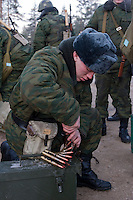 Kamenka, Karelia, Russia, 14/12/2007..A professional Russian soldier uses his knife to un-jam machine-gun belts during Snezhinka [Snowflake] 2007, a joint live fire training exercise for Russian and Swedish motorised infantry in which they play the roles of a combined peace-keeping force enforcing a demilitarised zone in a warring region.
