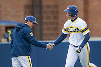 Michigan Wolverines first baseman Drew Lugbauer (17) rounds third base after hitting a home run against the Bowling Green Falcons on April 6, 2016 at Ray Fisher Stadium in Ann Arbor, Michigan. Michigan defeated Bowling Green 5-0. (Andrew Woolley/Four Seam Images)
