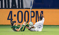 CARSON, CA - OCTOBER 07: Jorge Villafana #4 of the Portland Timbers  and Julian Araujo #22 of Los Angeles Galaxy collide during a game between Portland Timbers and Los Angeles Galaxy at Dignity Heath Sports Park on October 07, 2020 in Carson, California.