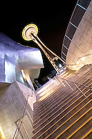 Nighttime scene of stairs leading up past Experience Music Project to Seattle Space Needle, Seattle Center, Seattle, Washington, US