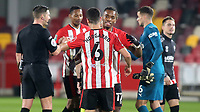 Brentford's Ivan Toney embraces Christian Norgaard at the final whistle to celebrate their 1-0 victory during Brentford vs Newcastle United, Carabao Cup Football at the Brentford Community Stadium on 22nd December 2020