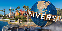 The famous Universal Globe under a blue sky, at the entrance of Universal Studios Florida theme park, Orlando, USA
