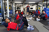 Jordan Ayew (FRONT) and team mates exercise in the gym during the Swansea City Training Session and Press Conference at The Fairwood Training Ground, Wales, UK. Thursday 29 March 2018