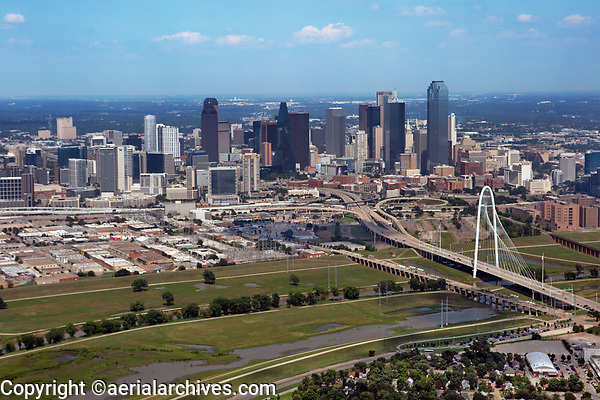 aerial photograph of the Dallas, Texas skyline, the Trinity River in the foreground, the Margaret Hunt Hill Bridge at right
