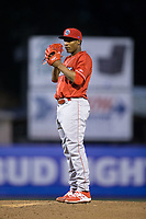 Lakewood BlueClaws starting pitcher Sixto Sanchez (23) looks to his catcher for the sign against the Kannapolis Intimidators at Kannapolis Intimidators Stadium on April 7, 2017 in Kannapolis, North Carolina.  The BlueClaws defeated the Intimidators 6-4.  (Brian Westerholt/Four Seam Images)
