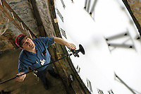 Wes McEachron, an instrument maker in the UW-Madison machine shop, has helped maintain the Music Hall clock since 1988. The clock was installed in the clocktower of what was then called Assembly Hall in 1879, and remains gravity-run 125 years later.<br /> <br /> Client: University of Wisconsin-Madison<br /> © UW-Madison University Communications 608-262-0067<br /> Photo by: Michael Forster Rothbart<br /> Date:  5/04    File#:   D100 digital camera frame 4494.
