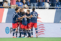 FOXOBOROUGH, MA - AUGUST 21: New England Revolution celebrate the goal by Tajon Buchanan #17 of New England Revolution during a game between FC Cincinnati and New England Revolution at Gillette Stadium on August 21, 2021 in Foxoborough, Massachusetts.