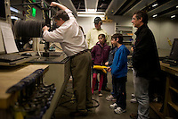 Visitors watch a demonstration of under water fabrication and cutting in the Fab Lab in the Media Lab during MIT's Under the Dome open house in Cambridge, Massachusetts, USA.
