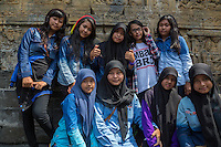 Borobudur, Java, Indonesia.  Young Indonesian Muslim Women Visiting Borobudur Temple.