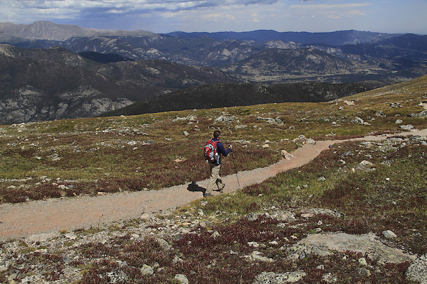 Caucasian man hiking the Flattop Mountain Trail in Rocky Mountain National Park, west of Estes Park, Colorado. .  John leads hikes and private photo tours in Boulder and throughout Colorado. Year-round.