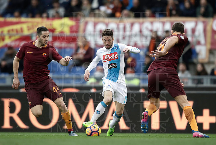 Napoli's Dries Mertens, center, is challenged by Roma's Kostas Manolas, left, and Federico Fazio, during the Serie A soccer match between Roma and Napoli at the Olympic stadium, 4 March 2017.<br /> UPDATE IMAGES PRESS/Isabella Bonotto