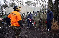Pictured: Footballers get briefed by Teamforce marshal. Tuesday 25 January 2011<br /> Re: Swansea City FC footballers and staff have spend a morning at Teamforce Paintball in Llangyfelach near Swansea south Wales.