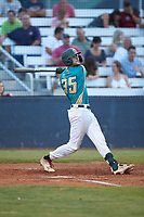 Jacob Whitley (35) (Charlotte) of the Mooresville Spinners follows through on his swing against the Concord A's at Moor Park on July 31, 2020 in Mooresville, NC. The Spinners defeated the Athletics 6-3 in a game called after 6 innings due to rain. (Brian Westerholt/Four Seam Images)