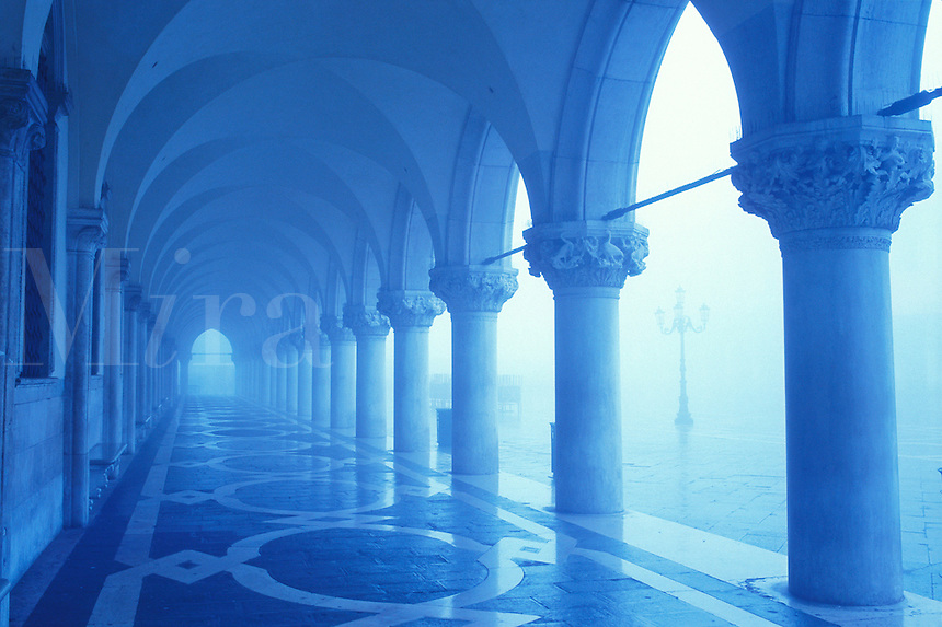 Italy, Venice. The Doge's Palace, columns and arches in the fog with blue tones