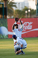 Left Fielder Michael Burgess #20 of the Daytona Beach Cubs catches a pop fly as Logan Watkins #5 tries to avoid contact  against the Brevard County Manatees at Jackie Robinson Ballpark on April 9, 2011 in Daytona Beach, Florida. Photo by Scott Jontes / Four Seam Images