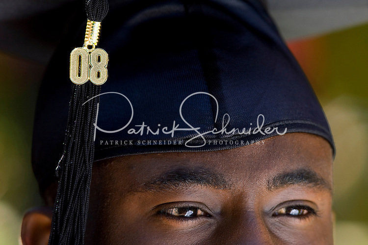 A graduate during a graduation ceremony Belmont Abbey College Graduation in Belmont Abbey.