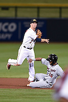 Mesa Solar Sox infielder Tony Renda (7) turns a double play as Eddie Rosario (16) slides in during an Arizona Fall League game against the Salt River Rafters on October 18, 2014 at Cubs Park in Mesa, Arizona.  Mesa defeated Salt River 8-4.  (Mike Janes/Four Seam Images)