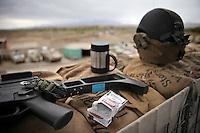 Afghanistan, 23.10.2011, Nawabad. Utensilien eines Kriegs auf Sandsaecken eines Wachturms. Die in Kundus stationierte 3. Task Force (ISAF) der Bundeswehr beginnt im Oktober 2011 die mehrtaegige Operation Orpheus. Durch Patrouillen in und um die Kleinstadt Nawabad (Dirstrikt Chahar Dareh) westlich von Kundus, Nordafghanistan, versuchen die rund 100 Infanteristen Rueckzugsorte Aufstaendischer unmoeglich zu machen. Unterstuetzt werden sie dabei durch einen Zug afghanischer Soldaten. Stuff on sand bags on the watchtower of the District Headquarters near Nawabad. In October 2011 Kunduz based 3.Task Force started a several days operation in and around Nawabad (District Chahar Dareh), west of Kunduz, northern Afghanistan. During the Operation Orpheus about 100 german infantry soldiers went out for patrols through the town and surrounding areas, which were expected as a retreat zone of insurgents. A platoon of afghan soldiers supports the german forces. © Timo Vogt/Est&Ost, NO MODEL RELEASE !! © Timo Vogt/Est&Ost, NO MODEL RELEASE !!