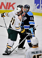 2 December 2011: University of Vermont Catamount forward H.T. Lenz, a Sophomore from Vienna, VA, has words with University of Maine Black Bear forward John Parker, a Freshman from Green Brook, NJ, at Gutterson Fieldhouse in Burlington, Vermont. The Catamounts fell to the Black Bears 6-4 in the first game of their 2-game Hockey East weekend series. Mandatory Credit: Ed Wolfstein Photo