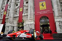 A Ferrari Formula 1 car in front of the stock exchange palace <br /> Milano 04-01-2016 Borsa <br /> Esordio in borsa per la Ferrari. <br /> The company Ferrari began trading at stock exchange today <br /> foto Daniele Buffa/Image Sport/Insidefoto
