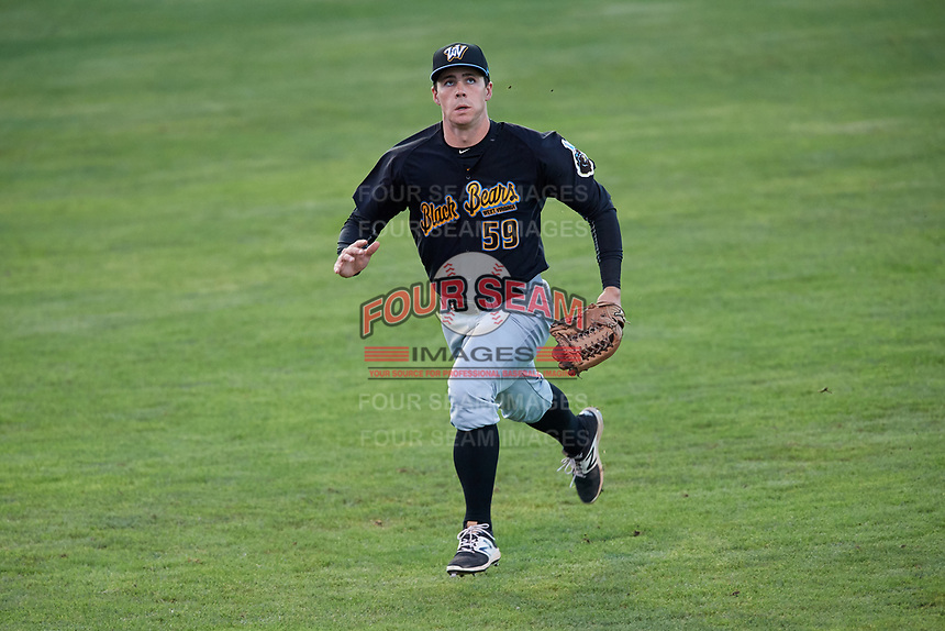 West Virginia Black Bears left fielder Lucas Tancas (59) tracks a fly ball during a game against the Batavia Muckdogs on August 5, 2017 at Dwyer Stadium in Batavia, New York.  Batavia defeated Williamsport 3-2.  (Mike Janes/Four Seam Images)