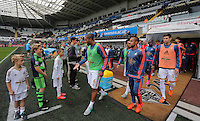 Swansea players led by Ashley Williams take to the pitch. Barclays Premier League match between Swansea City and Tottenham Hotspur played at The Liberty Stadium, Swansea on October 4th 2015
