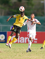 Romario Jones (8) of Jamaica heads the ball away from Romario Piggott (15) of Panama during the third place game of the CONCACAF Men's Under 17 Championship at Catherine Hall Stadium in Montego Bay, Jamaica. Panama defeated Jamaica, 1-0.