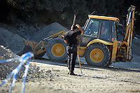 Pictured: A forensic officer and a digger operate at the site where Ben Needham disappeared from in Kos, Greece. Friday 14 October 2016<br />Re: Police teams led by South Yorkshire Police are searching for missing toddler Ben Needham on the Greek island of Kos.<br />Ben, from Sheffield, was 21 months old when he disappeared on 24 July 1991 during a family holiday.<br />Digging has begun at a new site after a fresh line of inquiry suggested he could have been crushed by a digger.