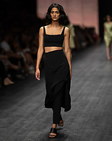 A model wearing a design by Manning Cartell walks at the Runway 3 show of the 2020 Virgin Australian Melbourne Fashion at the Royal Exhibition Building in Melbourne, Australia. Photo Sydney Low